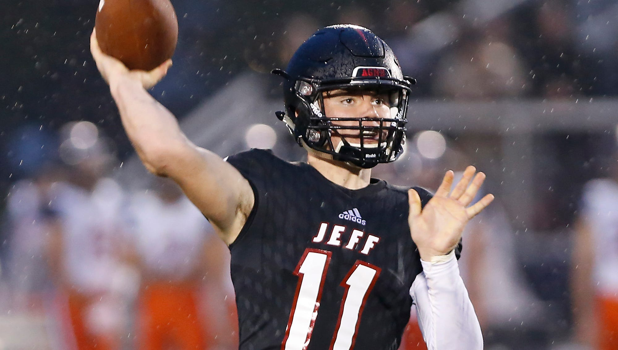 Lafayette Jeff quarterback Maximus Grimes with a touchdown pass to Zion Austin to put the Bronchos up 17-7 over Harrison in the second quarter Friday, September 7, 2018, at Scheumann Stadium.