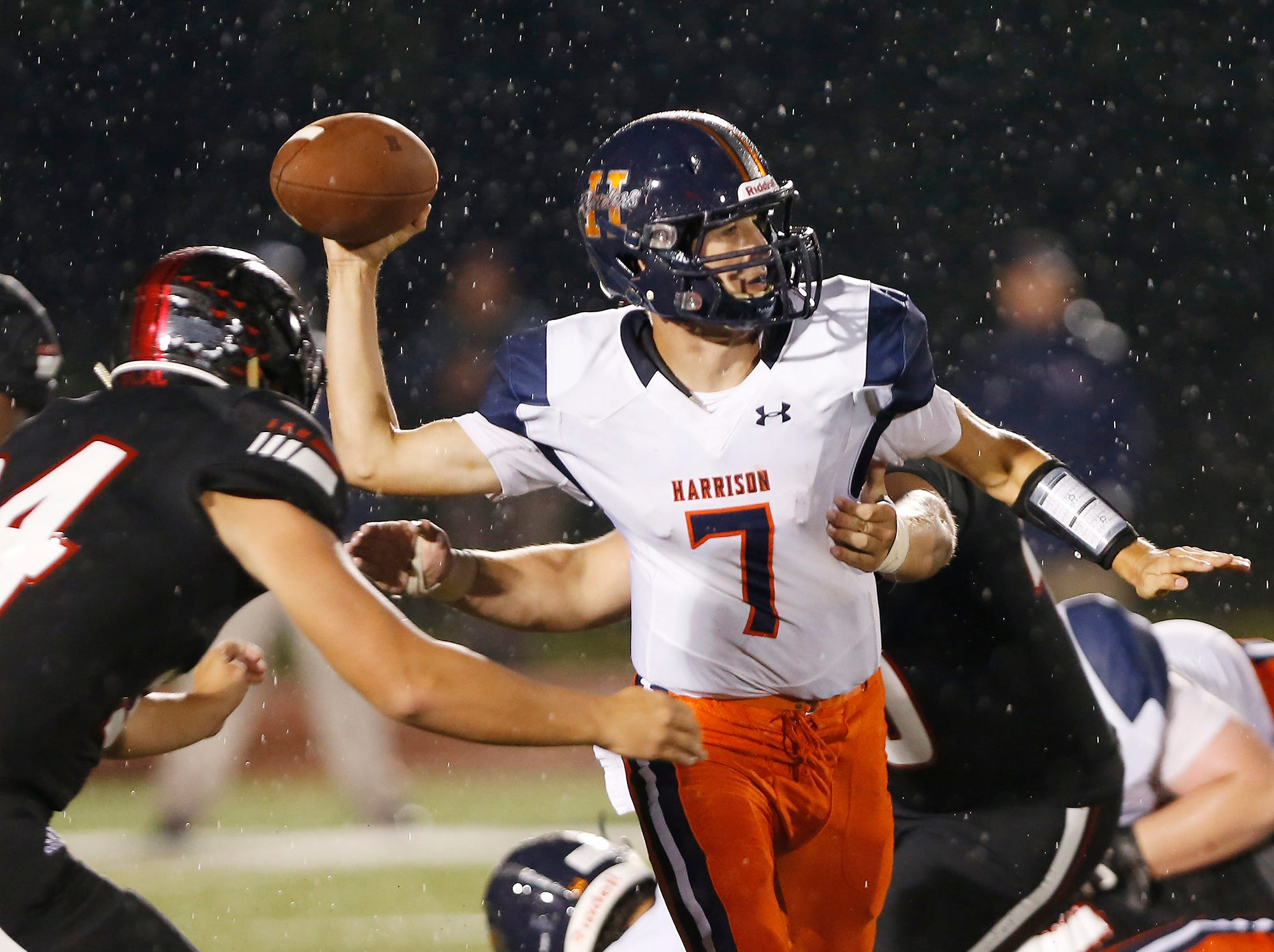 Harrison quarterback Andrew Jensen looks to get off a pass before being sacked by the Lafayette Jeff defense Friday, September 7, 2018, at Scheumann Stadium. Jeff defeated Harrison 31-14.