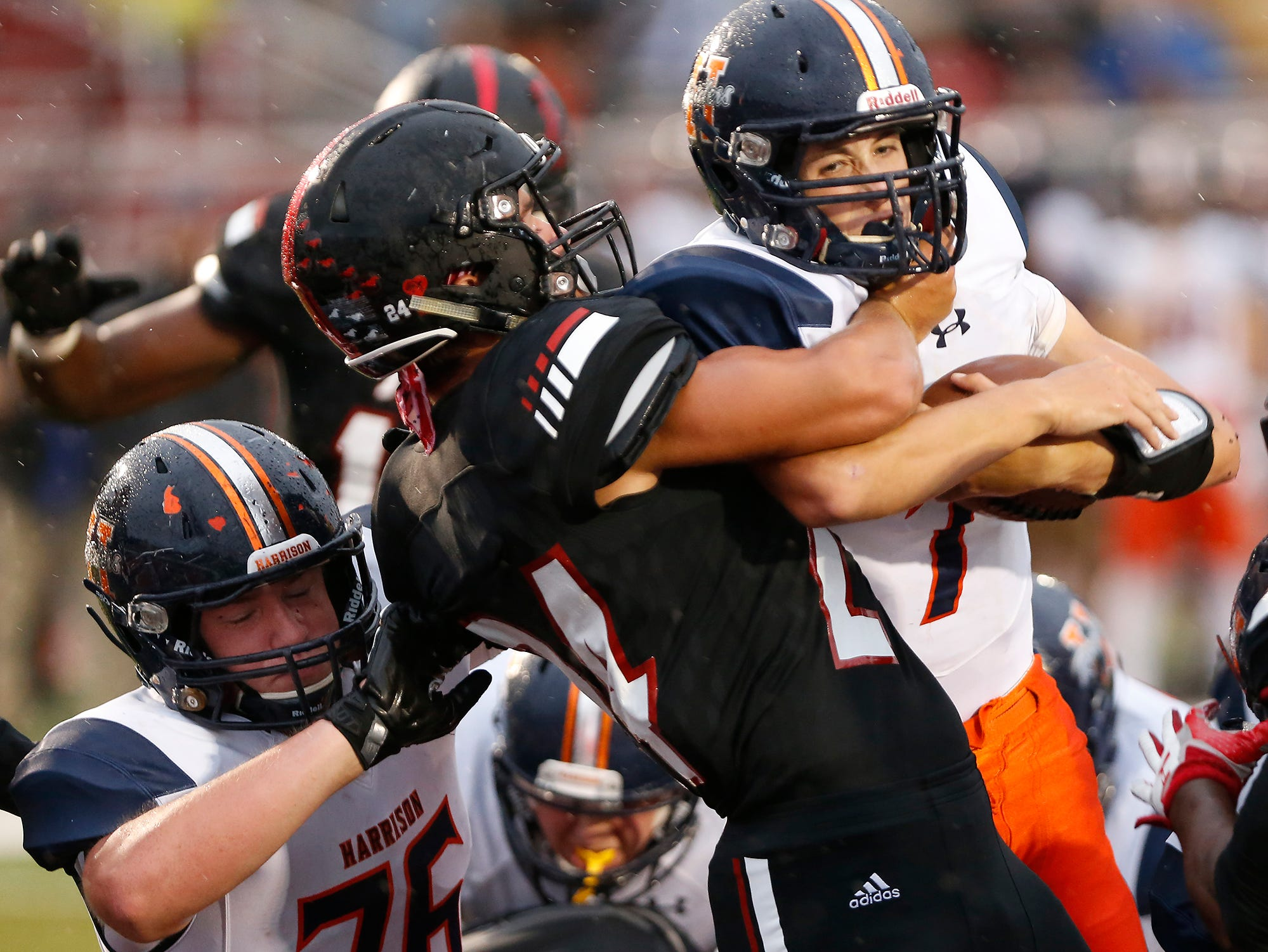 Harrison quarterback Andrew Jensen, right, muscles his way into the endzone for a Raiders touchdown at 11:55 in the second quarter against Lafayette Jeff Friday, September 7, 2018, at Scheumann Stadium. Jeff defeated Harrison 31-14.