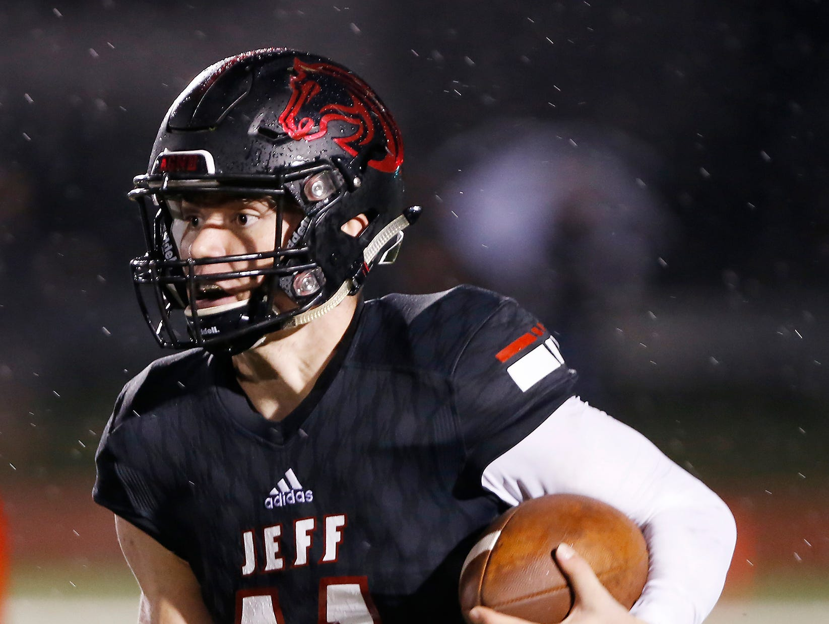 Lafayette Jeff quarterback Maximus Grimes with a carry against Harrison in the third quarter Friday, September 7, 2018, at Scheumann Stadium. Jeff defeated Harrison 31-14.