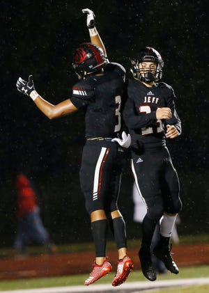 Garrett Price, right, of Lafayette Jeff celebrates with teammate Quentin Stepheny after intercepting a Harrison pass with 5:33 remaining in the fourth quarter Friday, September 7, 2018, at Scheumann Stadium. Jeff defeated Harrison 31-14.