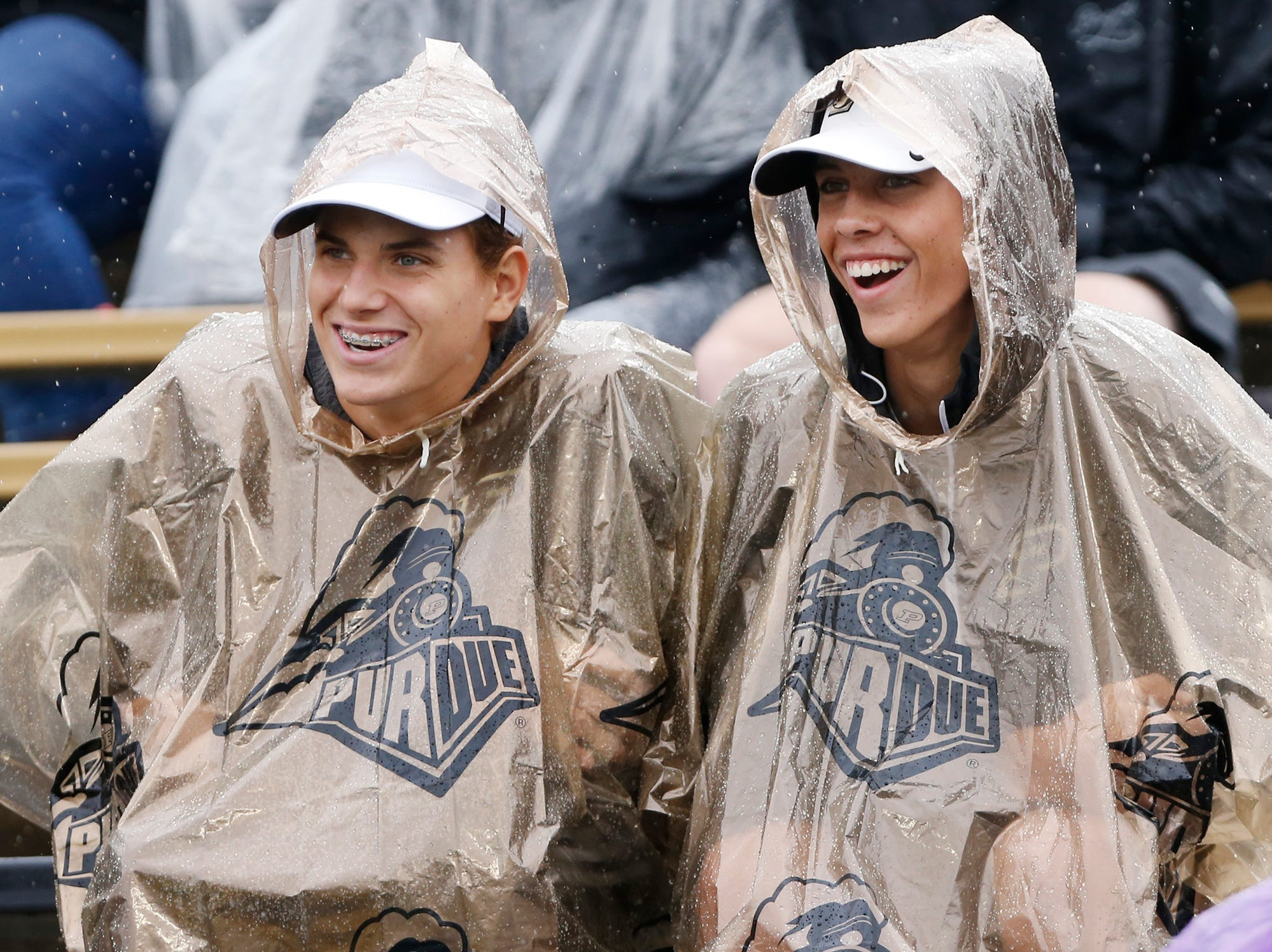 Purdue fans brave the weather as the Boilermakers host Eastern Michigan Saturday, September 8, 2018, in West Lafayette. They didn't have a lot to smile about, as Purdue fell to Eastern Michigan 20-19 on a field goal as time expired.