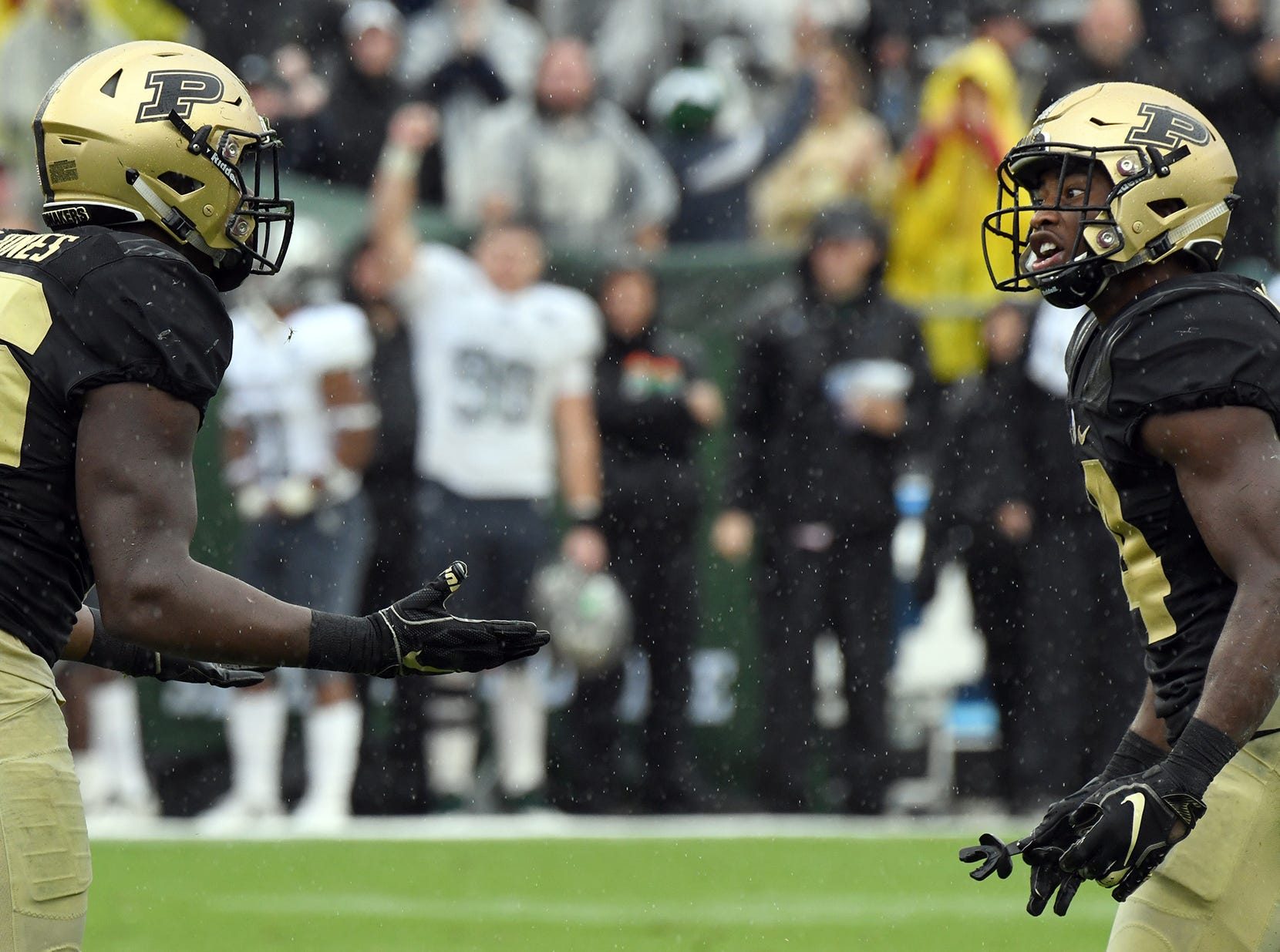 Purdue's Rondale Moore, right, and Cornel Jones discuss a personal foul call in the fourth quarter in West Lafayette on September 8, 2018. Purdue lost 20-19 to Eastern Michigan.