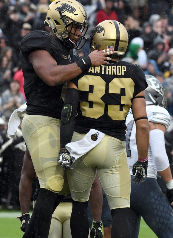 Purdue's Markell Jones, left, and Jackson Anthrop celebrate a touchdown by Jones in West Lafayette on September 8, 2018. Purdue lost 20-19.