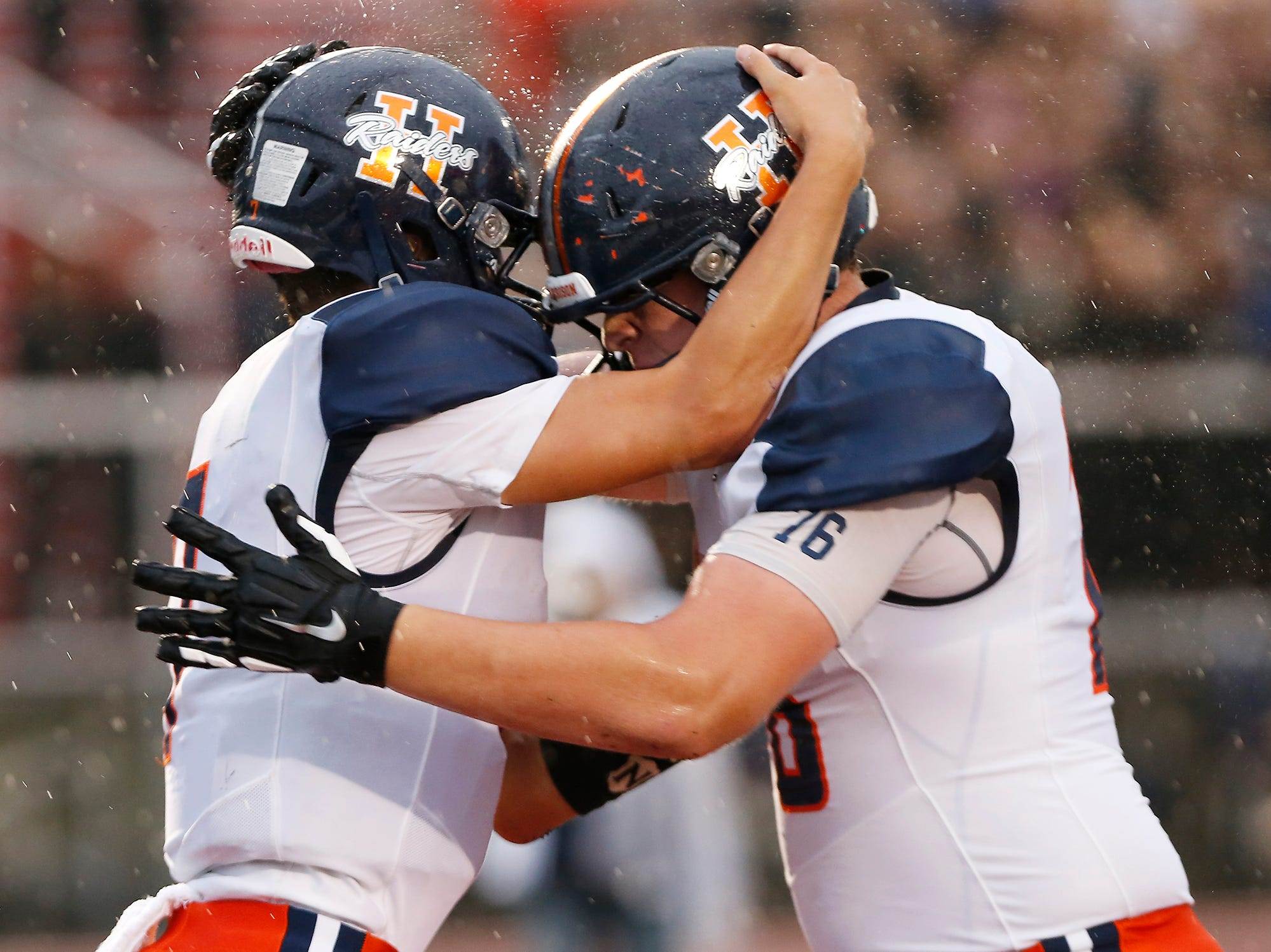 Harrison quarterback Andrew Jensen celebrates with teammate William Kern after his rushing touchdown at 11:55 in the second quarter against Lafayette Jeff Friday, September 7, 2018, at Scheumann Stadium. Jeff defeated Harrison 31-14.