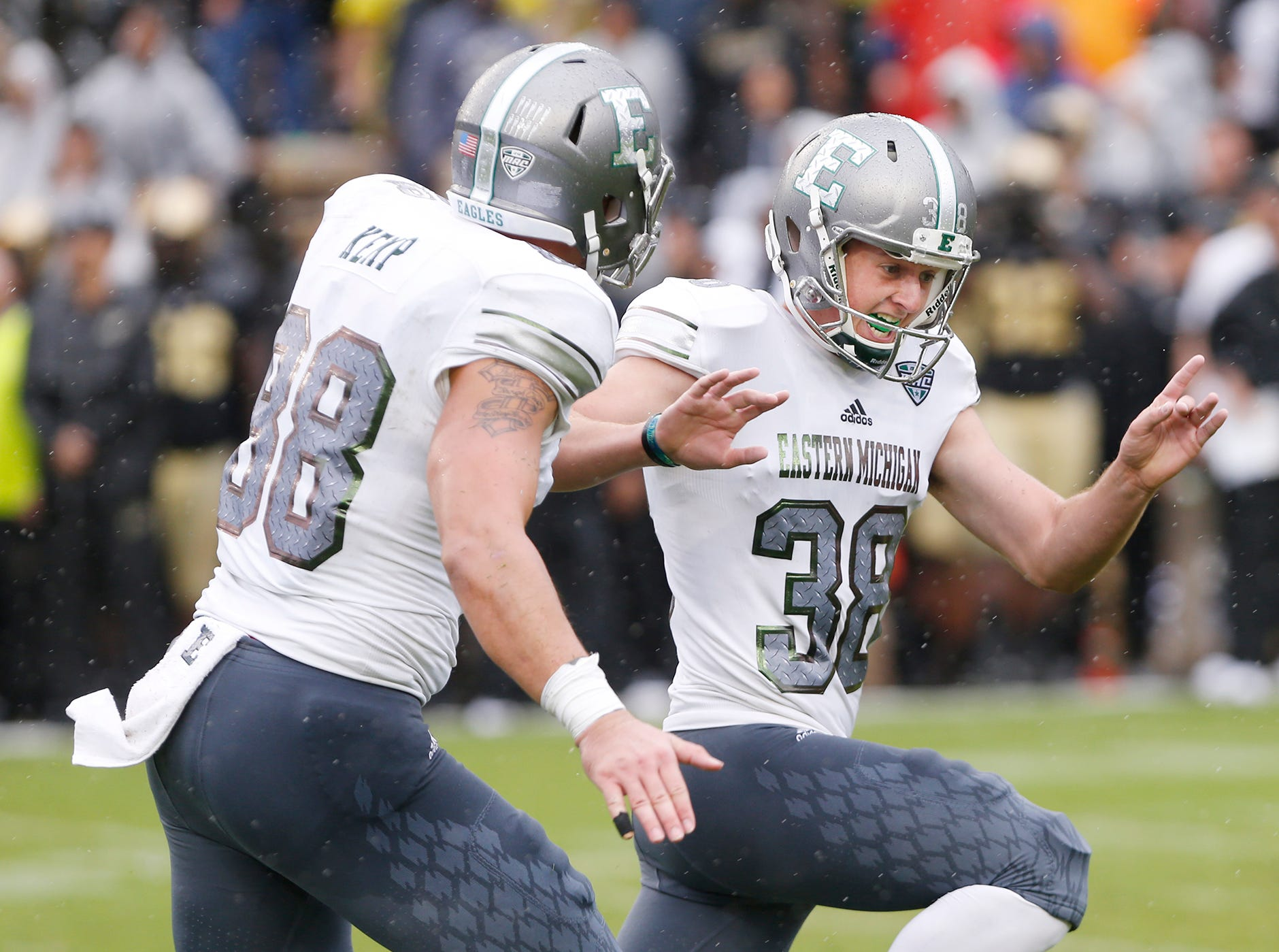 Eastern Michigan kicker Chad Ryland, right, reacts after his field goal as time ran out lifted the Eagles to a 20-19 victory over Purdue Saturday, September 8, 2018, in West Lafayette.