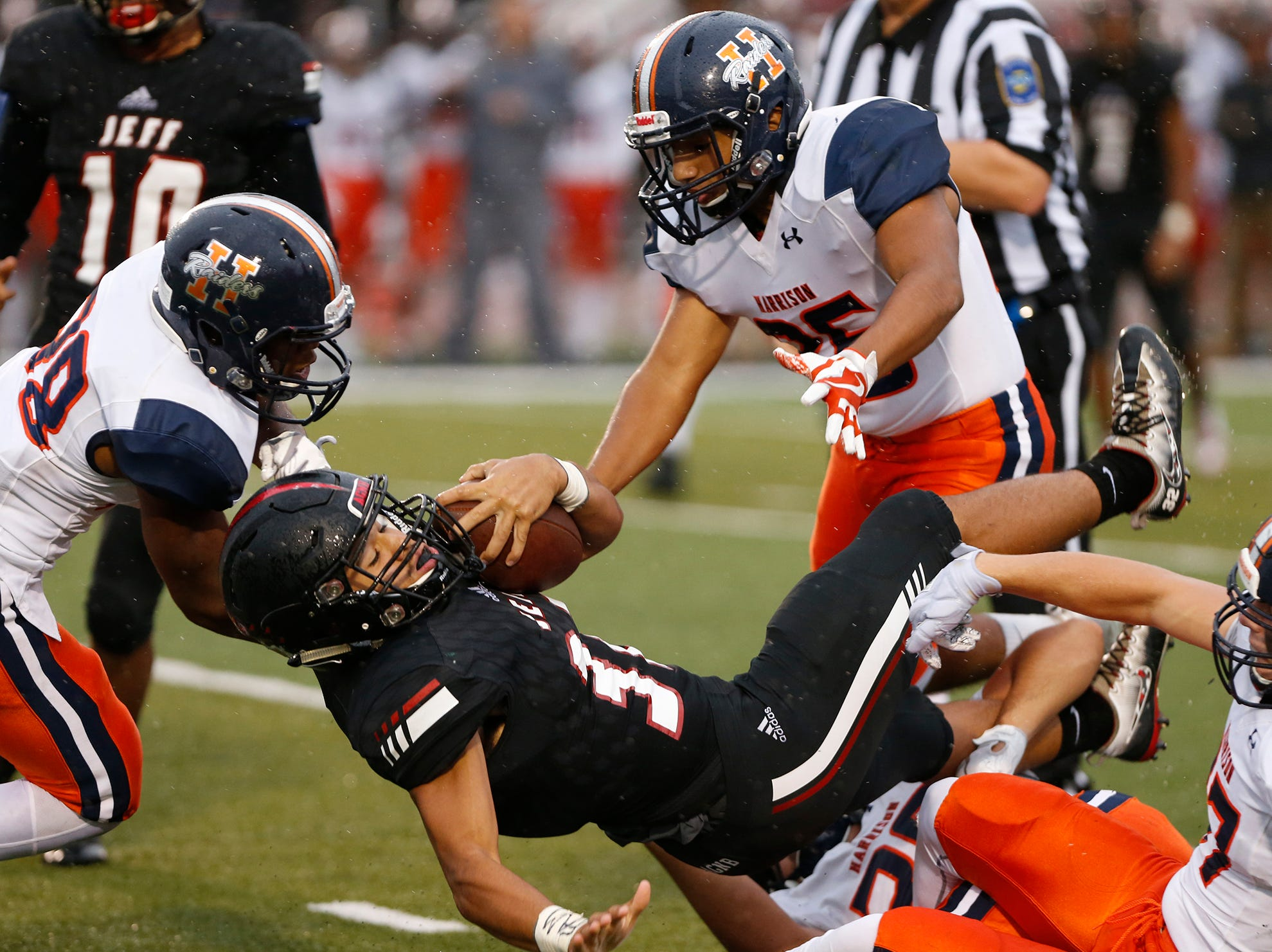 Marquis Munoz of Lafayette Jeff is brought down after a short gain against Harrison Friday, September 7, 2018, at Scheumann Stadium. Jeff defeated Harrison 31-14.