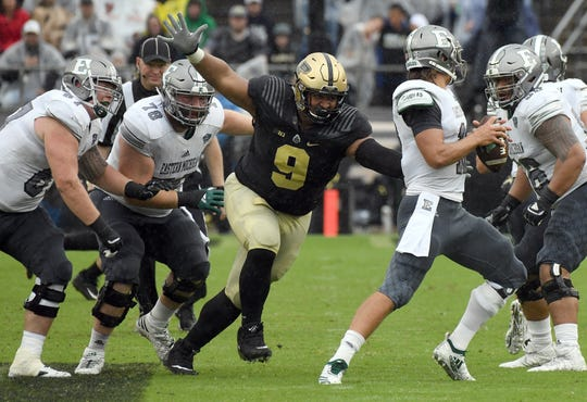 Purdue's Lorenzo Neal sacks Eastern Michigan's Tyler Wiegers in West Lafayette on September 8, 2018. Purdue lost 20-19.