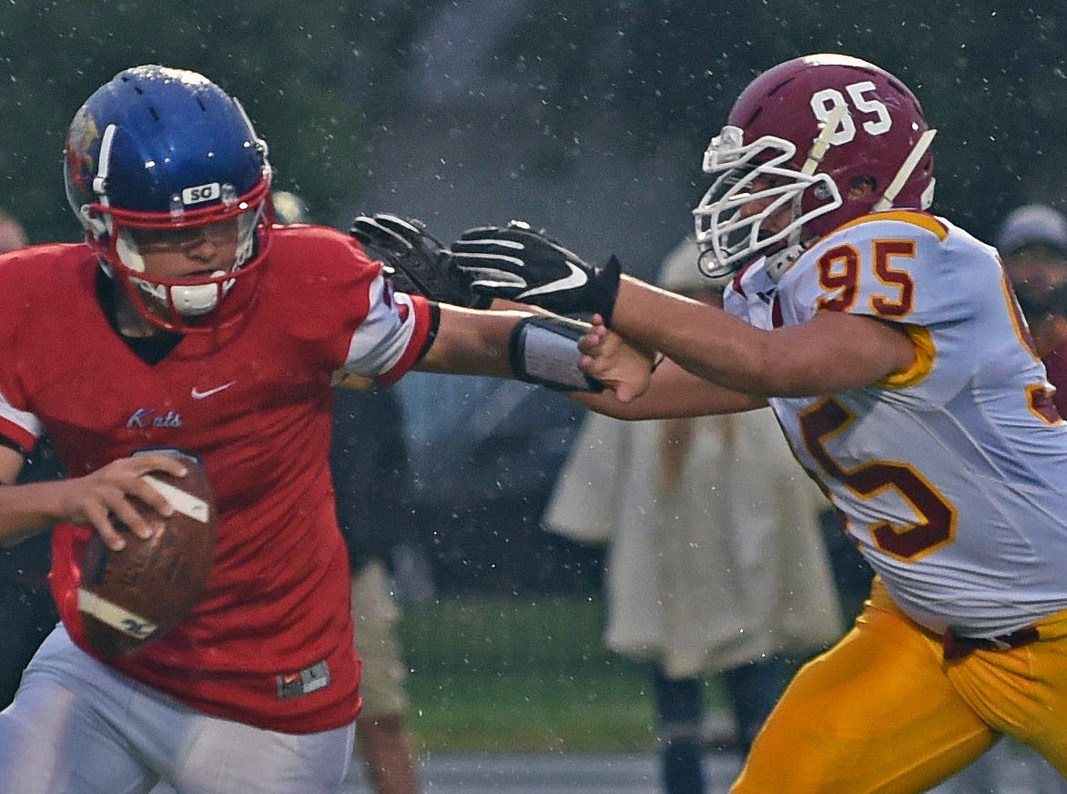 A rainy night of football in Kokomo as the Mavericks skin the Wildkats. Deshun Sanders.