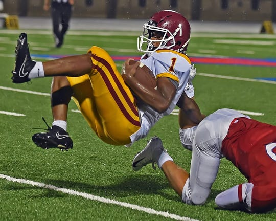 Maverick junior Stephen McWilliams rolls off the back of a Wildkat tackle Friday.