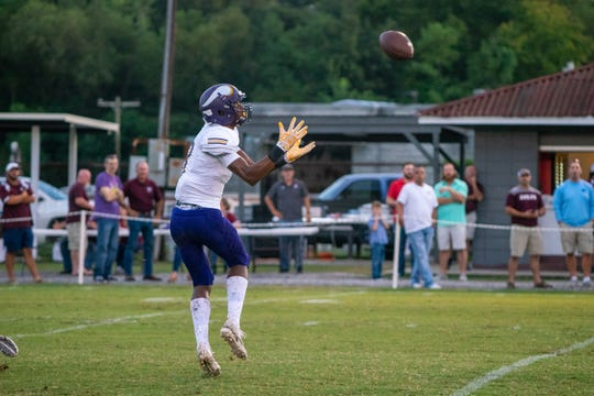 OCHS's Keon Coleman catches a pass as the Vermilion Catholic Eagles play at home against the Opelousas Catholic Vikings on Sept. 7, 2018.