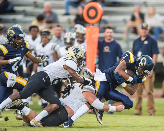 Carencro's Kindler Williams (7) goes up the middle for the first down on Friday Sept. 7, 2018.