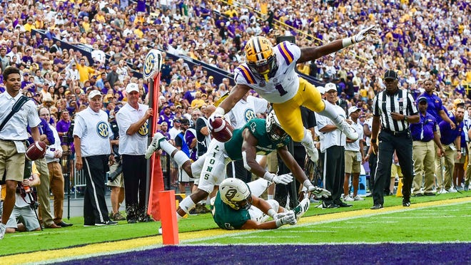 LSU wide receiver Ja'Marr Chase catches a 9-yard touchdown pass from quarterback Joe Burrow to give Tigers a 7-0 lead over Southeastern Louisiana in the first quarter Saturday night at Tiger Stadium.
