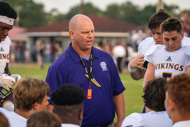 OCHS's head coach Thomas David talks to his team before the game as the Vermilion Catholic Eagles play at home against the Opelousas Catholic Vikings on Sept. 7, 2018.