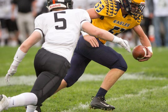 Brighton's Cole Riddle (5) moves in to tackle Hartland's Griffin Neuer on Friday, Sept. 7, 2018.