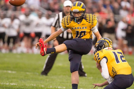 Freshman Nathan Dibert kicks a 23-yard field goal to give Hartland a 10-7 lead in the second quarter of a 28-10 loss to Brighton on Friday, Sept. 7, 2018.