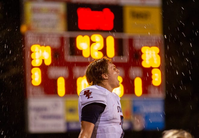 Quarterback McCall Ray celebrates late in the game. Bedford North tops New Albany in the final seconds 41-40, Friday, Sept. 7, 2018 in New Albany, Ind.