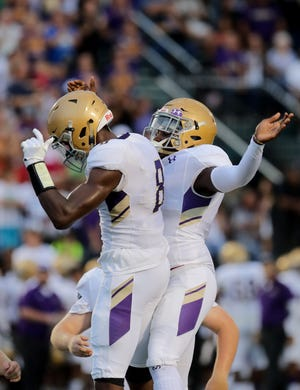Male's Izayah Cummings celebrates with his teammate after scoring a touchdown. Sept. 7, 2018