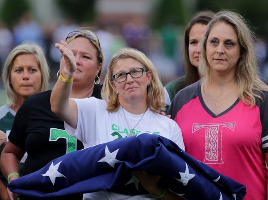Jennifer Albright thanks the crowd at Trinity's football game. Her son Davey Albright died earlier in the day. Sept. 7, 2018