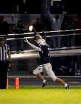 East Lansing's Jack Morse reflects on his winning touchdown catch in the final minute of the Trojans' 31-28 win over Grand Ledge.