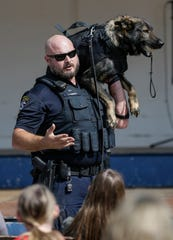 Manitowoc police officer Jason Koenig does a demonstration with K-9 Neko during Sputnikfest at the Rahr-West Museum Saturday, September 8, 2018, in Manitowoc, Wis. Josh Clark/USA TODAY NETWORK-Wisconsin