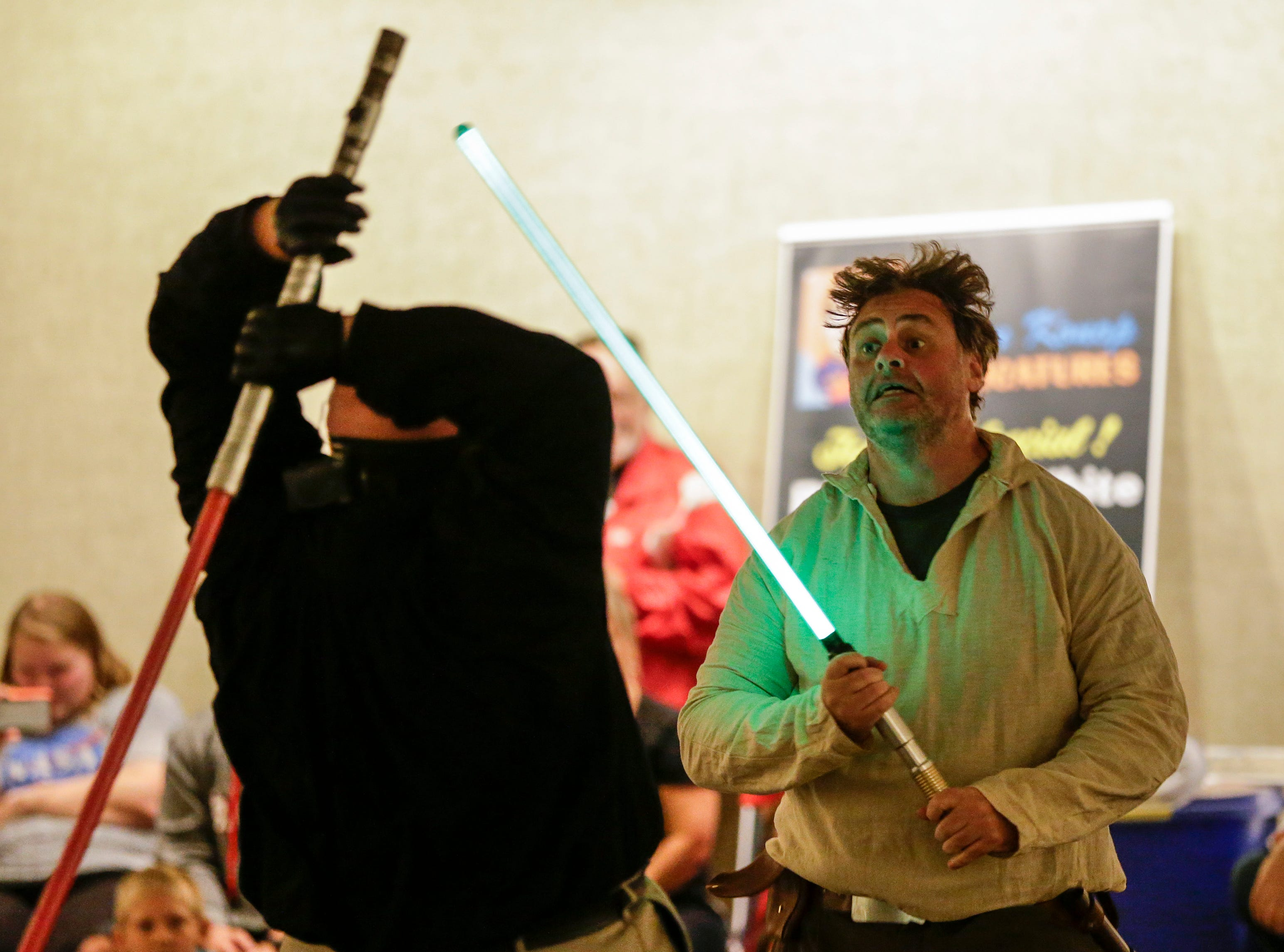 John Hartley of Sheboygan performs in a light saber duel during Sputnikfest at the Rahr-West Museum Saturday, September 8, 2018, in Manitowoc, Wis. Josh Clark/USA TODAY NETWORK-Wisconsin
