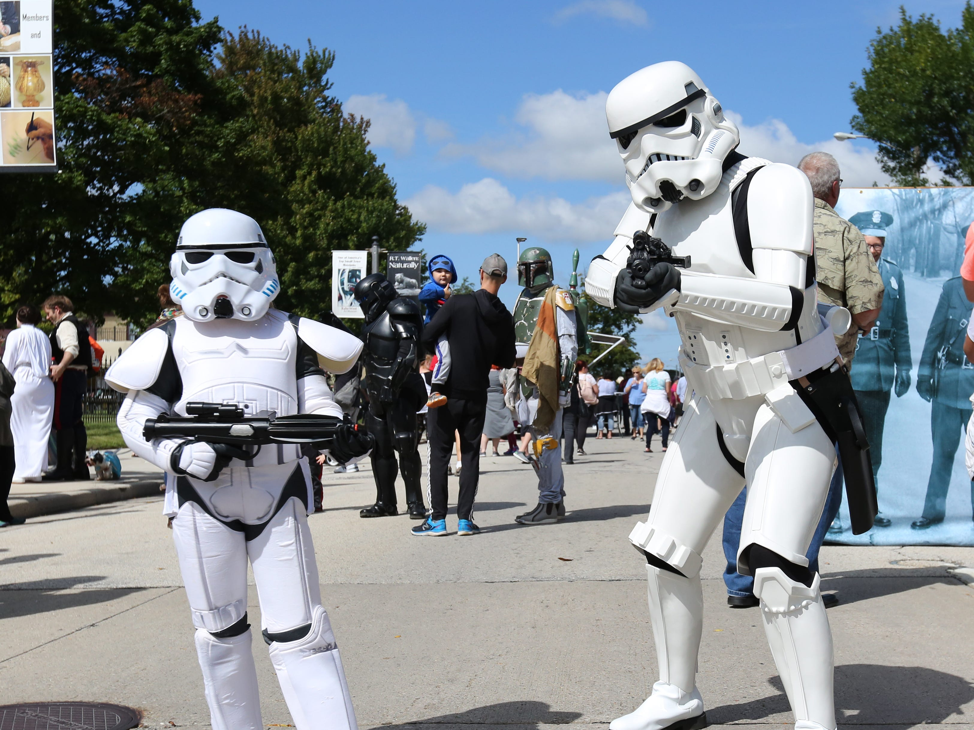 Lauren Pribbernow, 7, and her dad Ryan, of Marshfield, pose as stormtroopers during Sputnikfest at the Rahr-West Museum Saturday, September 8, 2018, in Manitowoc, Wis. Josh Clark/USA TODAY NETWORK-Wisconsin