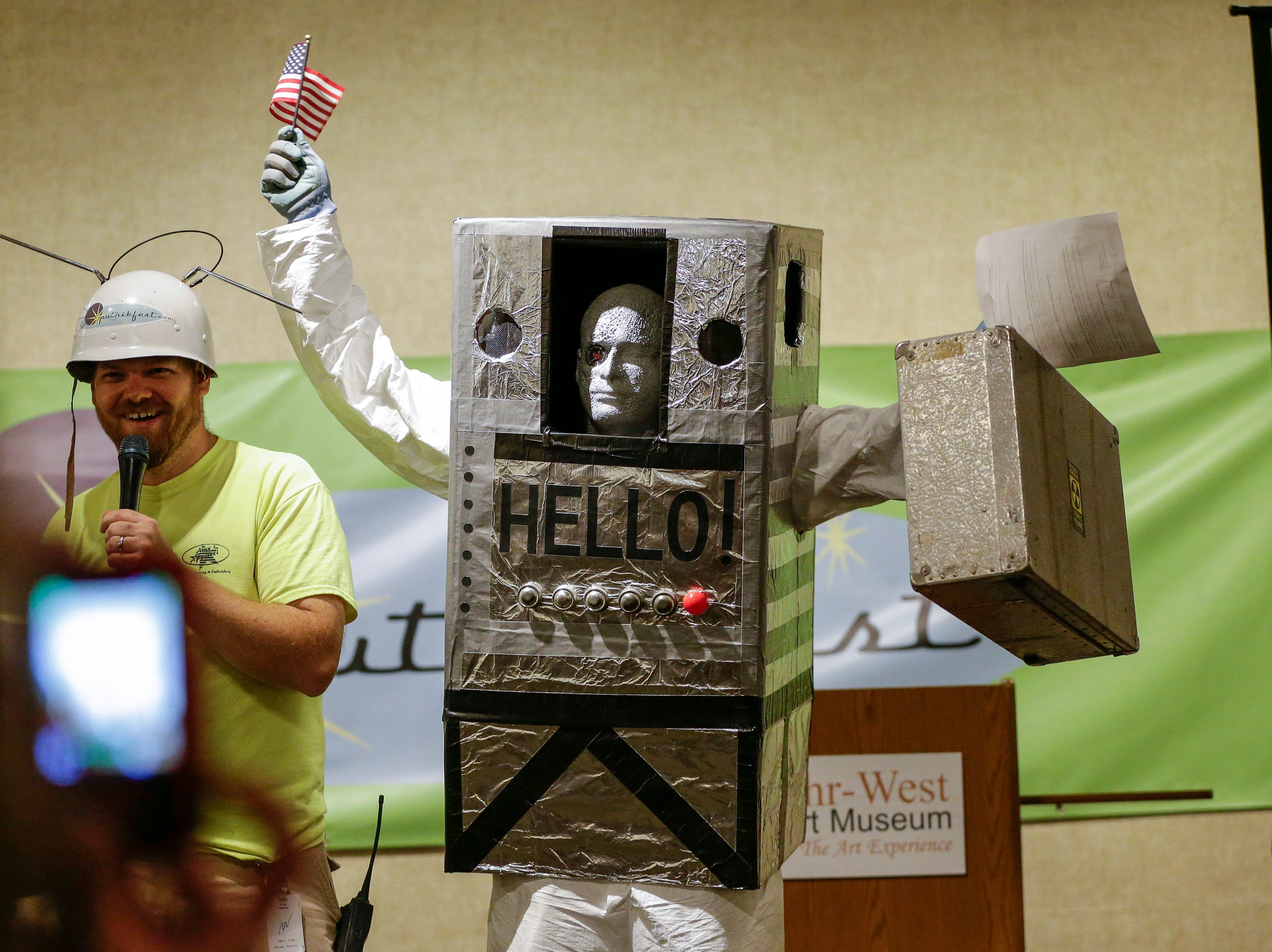 Martin Morante of Random Lake, dressed as an alien space traveller, reacts to winning the Sputnikfest costume contest at the Rahr-West Museum Saturday, September 8, 2018, in Manitowoc, Wis. Josh Clark/USA TODAY NETWORK-Wisconsin