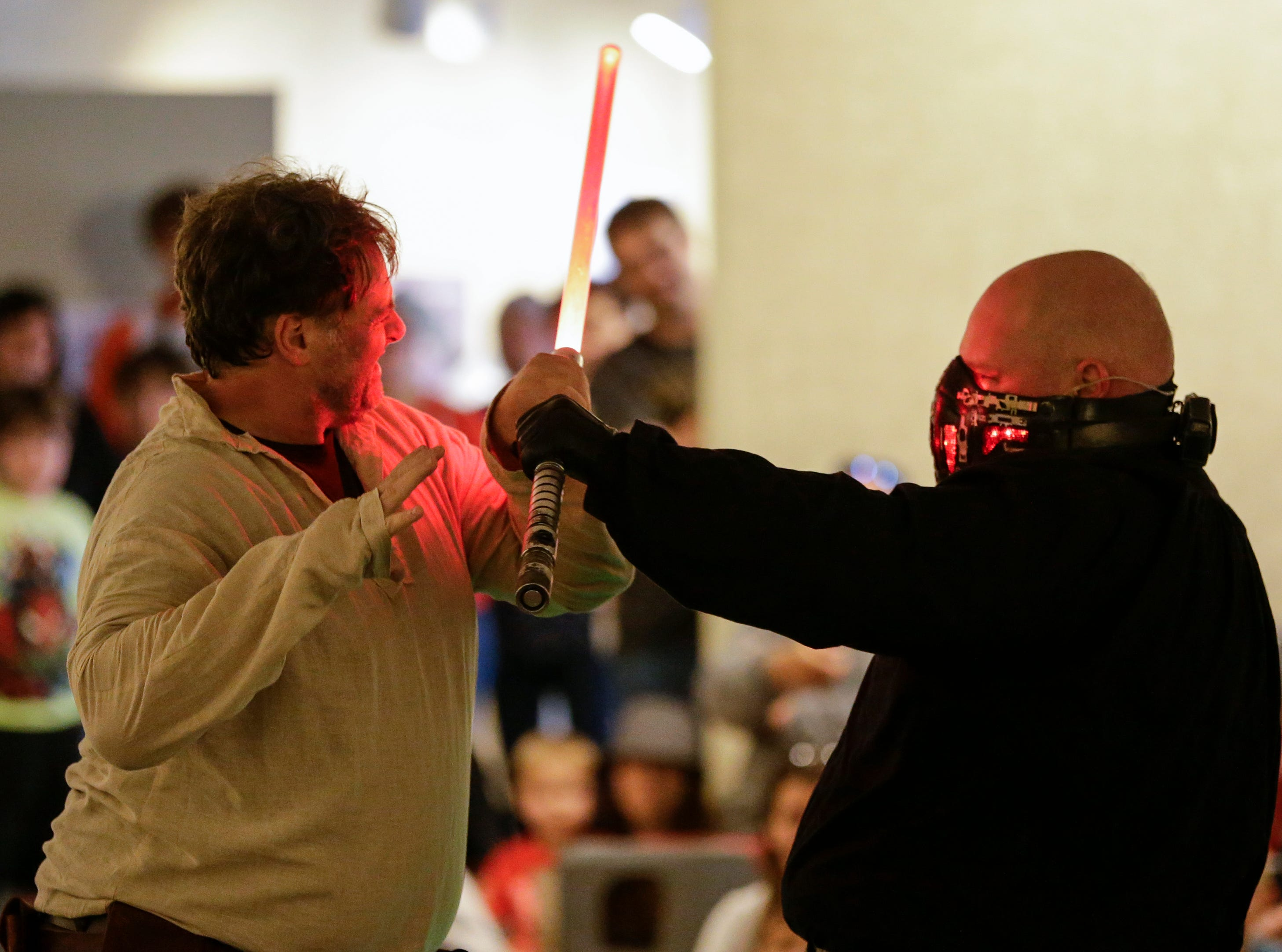 Members of the Rebel Legion battle in a light saber duel during Sputnikfest at the Rahr-West Museum Saturday, September 8, 2018, in Manitowoc, Wis. Josh Clark/USA TODAY NETWORK-Wisconsin