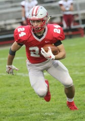 Shelby's Owen Fisher runs with the ball while playing a home game against Willard on Friday.
