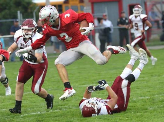 Shelby's Uriah Schwemley leaps over the Willard defense during a home game on Friday.