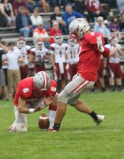 Shelby's Uriah Schwemley kicks the ball while playing a home game against Willard in Week 3.