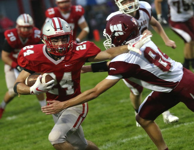 Shelby's Owen Fisher fends off a Willard player during a home game on Friday.
