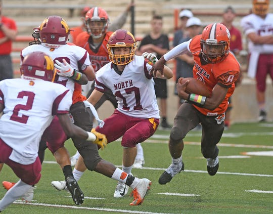 Mansfield's Angelo Grose finds room to run in the first half against Westerville North on Friday night at Arlin Field.