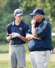 Galion's Matt McMullen and coach Bryce Lehman talk at the No. 5 tee during Friday's City Golf Tournament at Oak Tree. McMullen won a two-hole playoff with Lexington's Taylor Wittmer for medalist honors and the Tigers beat Lex in a one-hole playoff for their fourth tournament title of the season.
