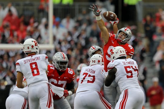 Ohio State defensive end Nick Bosa attempts to deflect a pass from Rutgers' true freshman quarterback Artur Sitkowski.