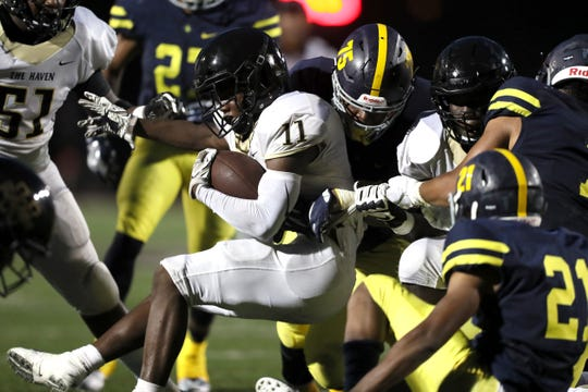 Whitehaven's Cameron Sneed is brought down by a host of Lausanne defenders, including Gary Walton, center, at Rhodes College on Friday, Sept. 7, 2018.