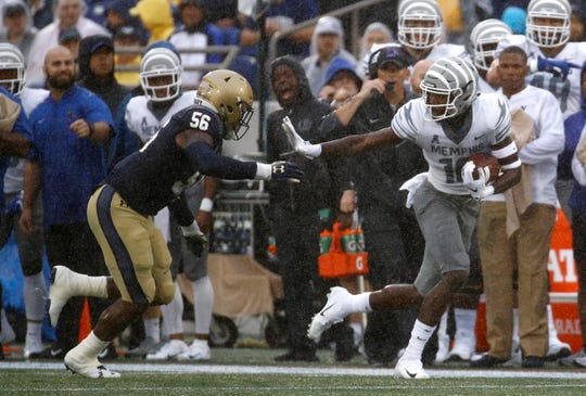 Memphis wide receiver Damonte Coxie, right, rushes past Navy linebacker Nizaire Cromartie in the first half of an NCAA college football game, Saturday, Sept. 8, 2018, in Annapolis, Md. (AP Photo/Patrick Semansky)