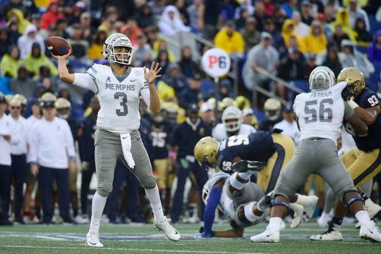 Memphis Tigers quarterback Brady White (3) throws during the first quarter against the Navy Midshipmen at Navy-Marine Corps Memorial Stadium.