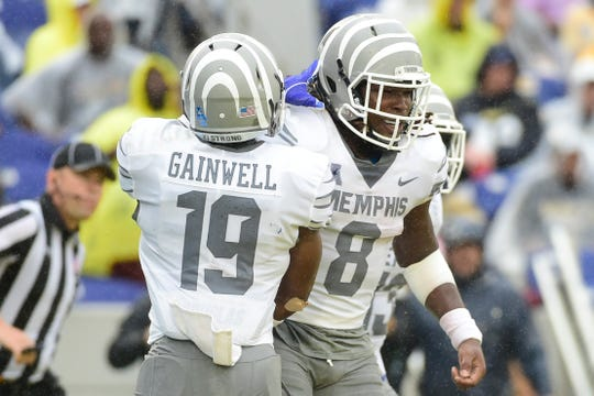 Memphis Tigers running back Darrell Henderson (8) celebrates with running back Kenny Gainwell (19)  after scoring a second quarter touchdown against the Navy Midshipmen at Navy-Marine Corps Memorial Stadium.