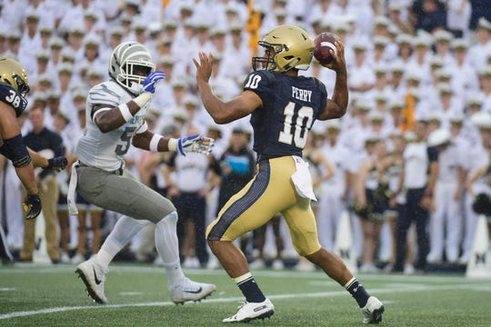 Navy Midshipmen quarterback Malcolm Perry (10) drops back to pass during the first quarter against the Memphis Tigers at Navy-Marine Corps Memorial Stadium.
