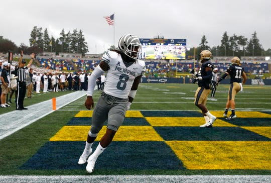Memphis running back Darrell Henderson (8) celebrates after scoring a touchdown in the first half of an NCAA college football game against Navy, Saturday, Sept. 8, 2018, in Annapolis, Md. (AP Photo/Patrick Semansky)