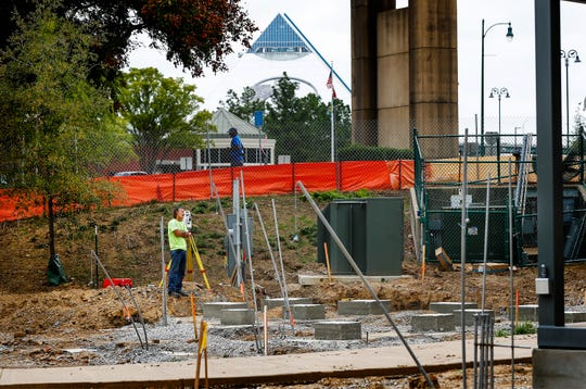 """Workers line up concrete foundation blocks at Mississippi River Park Thursday afternoon. The park will undertake a $1.6 million redesign and open in November. The redesign will feature a garden-like setting with plants that bloom during different seasons, a tree house for all ages and """"nests"""" for people to gather."""