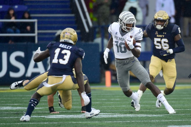 Memphis Tigers wide receiver Damonte Coxie (10) runs in-between Navy Midshipmen defenders after a catch during the first quarter at Navy-Marine Corps Memorial Stadium.