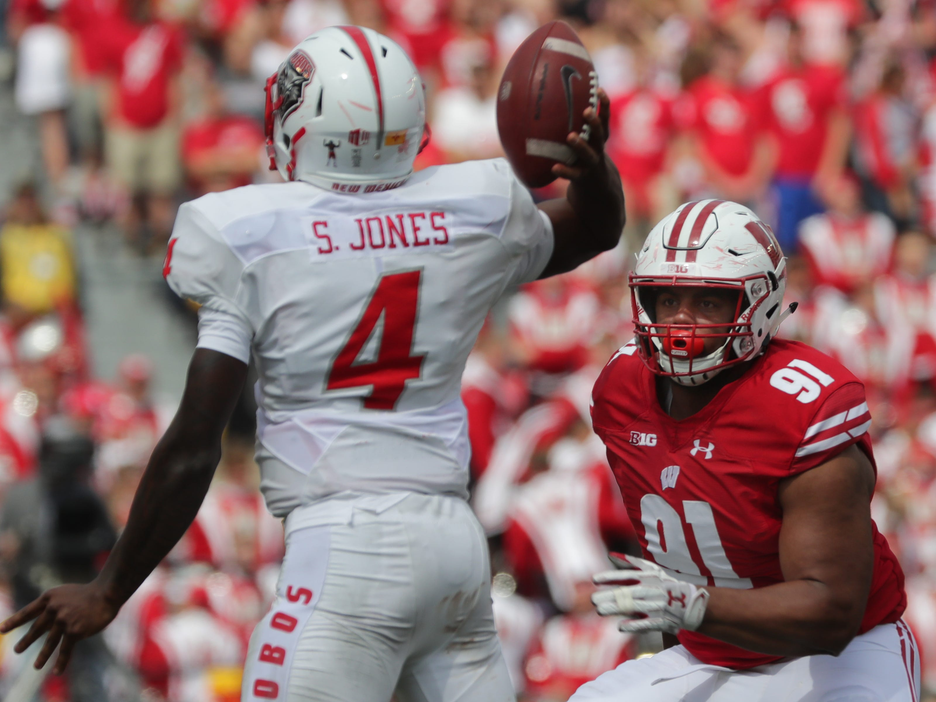 Wisconsin nose tackle Bryson Williams pressures New Mexico quarterback Sheriron Jones.