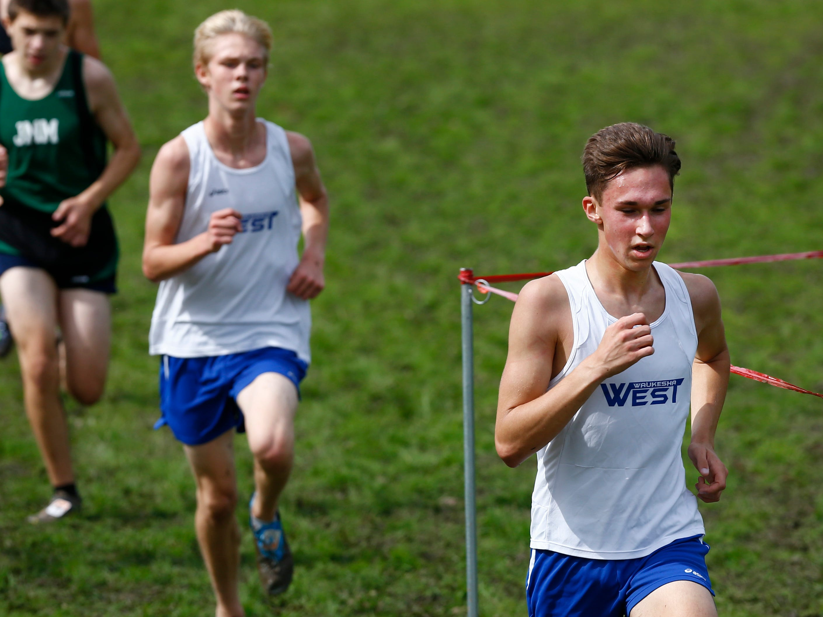 Waukesha West's Jake Richmond is trailed by Landen Bratt in the final stretch of the Menomonee Falls Matt Hadler Cross Country Invitational at Rotary Park where Richmond finished 22nd and Bratt 26th of 100 runners on Sept. 8.