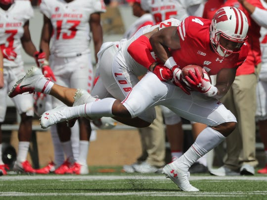 Wisconsin wide receiver A.J. Taylor holds on to the ball while being covered by New Mexico safety Marcus Hayes during a for 31-yard pass play last September. The play was just one of four passes that covered 30 or more yards last season for the Badgers.