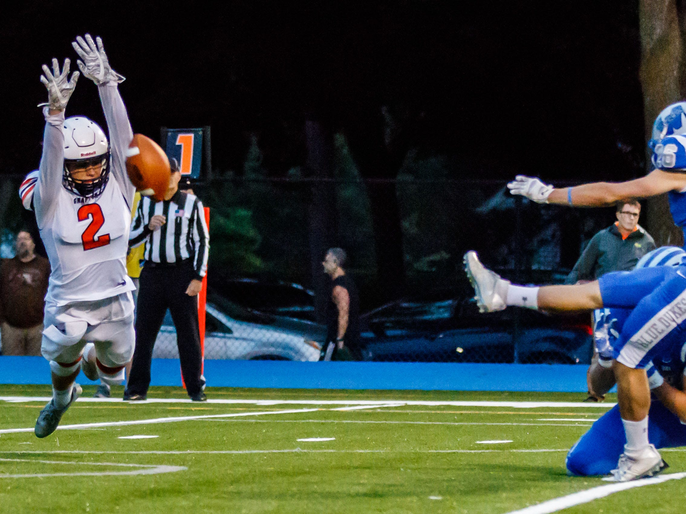 Grafton defensive back Calen Knauer (2) attempts to block a PAT by Whitefish Bay kicker Michael Kauffman (26) during the game at Whitefish Bay on Friday, Sept. 7, 2018.