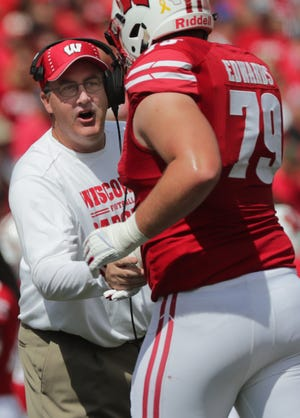 Wisconsin heads coach Paul Chryst greets offensive lineman David Edwards after a touchdown.