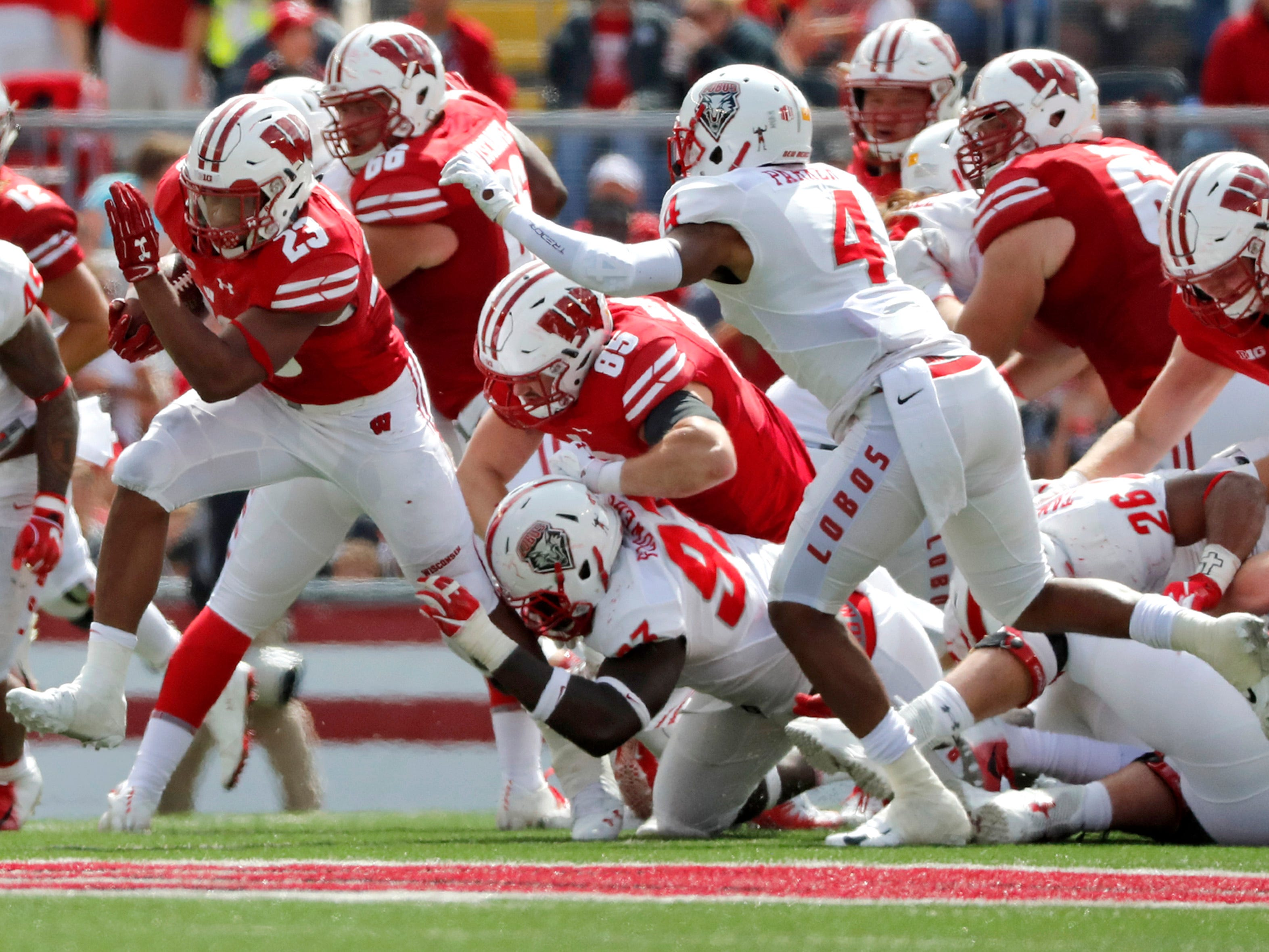 Wisconsin running back Jonathan Taylor  breaks through the defense.